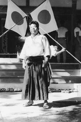 Morihiro Saito in front of the Aiki Jinja 1960